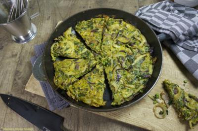 omelet met doperwtjes en spinazie