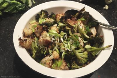 Geroosterde bloemkool en broccoli met soja en sesam