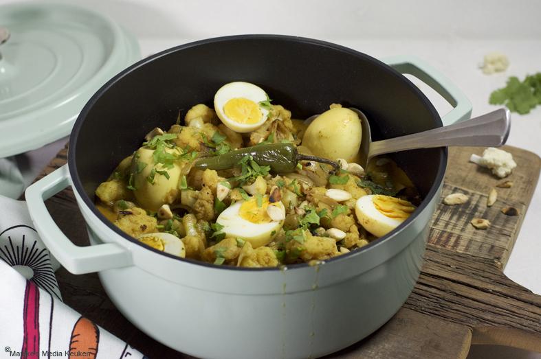 Snelle bloemkoolcurry met ei en amandelen maken